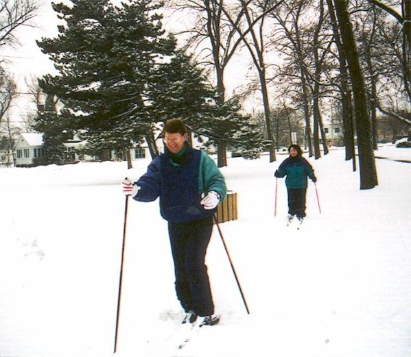 A couple cross country skiing.