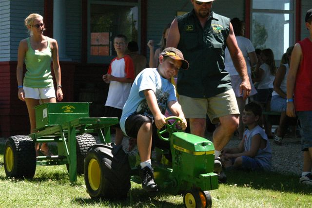 Young Boy Riding Toy Tractor