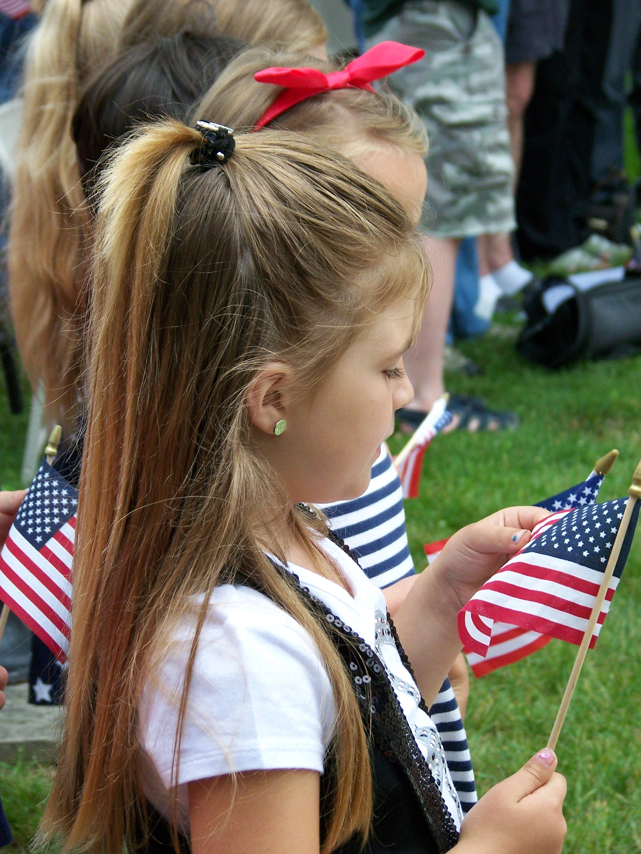 A Young Girl with a Small American Flag