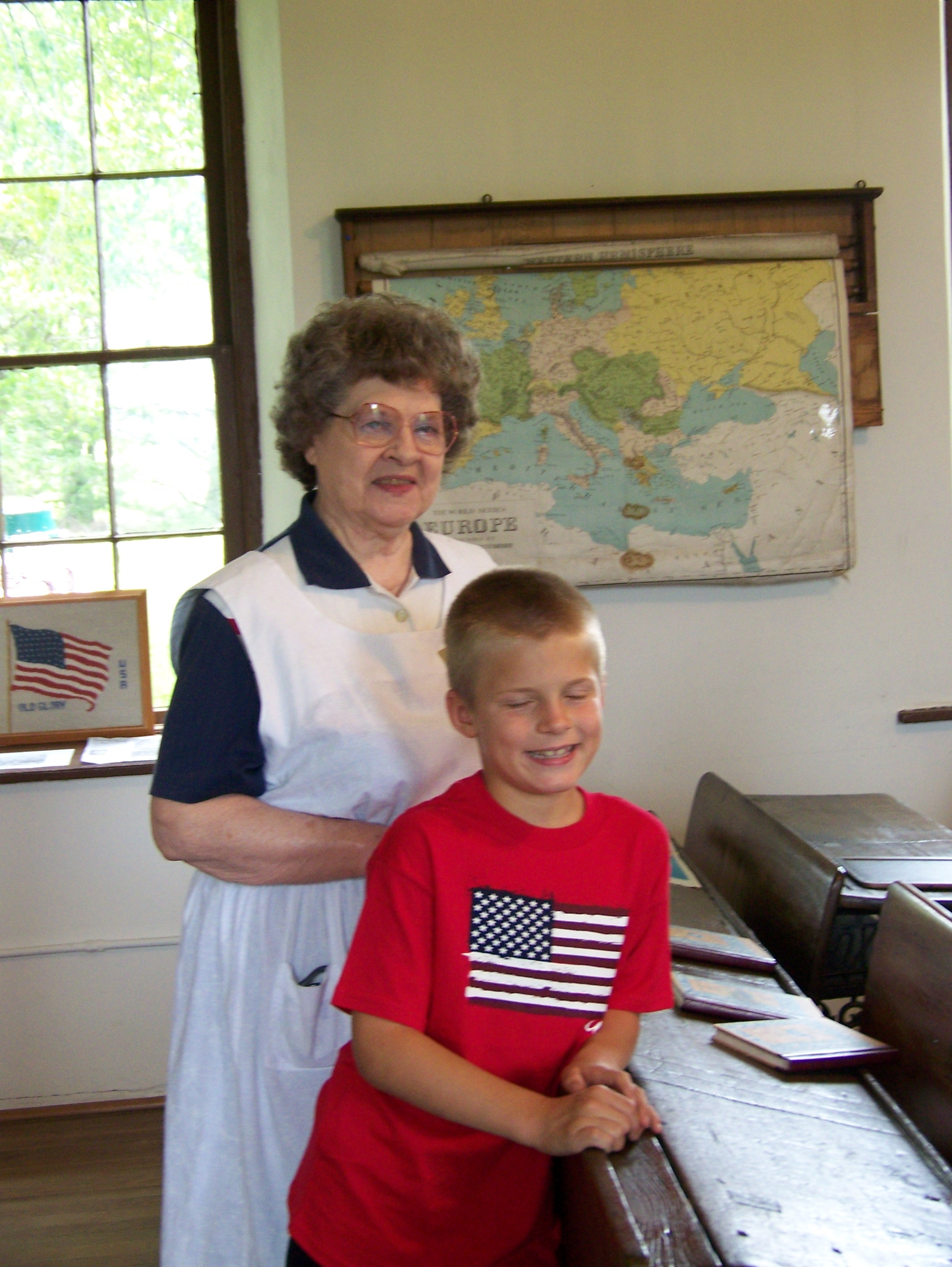 Older Woman and Young Boy in Small Old Schoolroom
