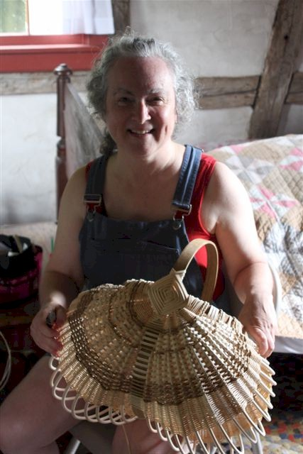 Smiling Woman With Her Craft