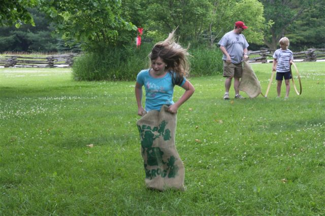 Girl in Burlap Sack Hopping Around