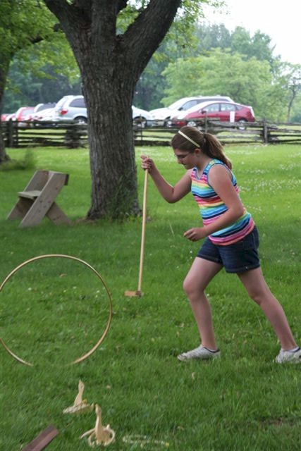 Old Timely Game Played by Adolescent Girl