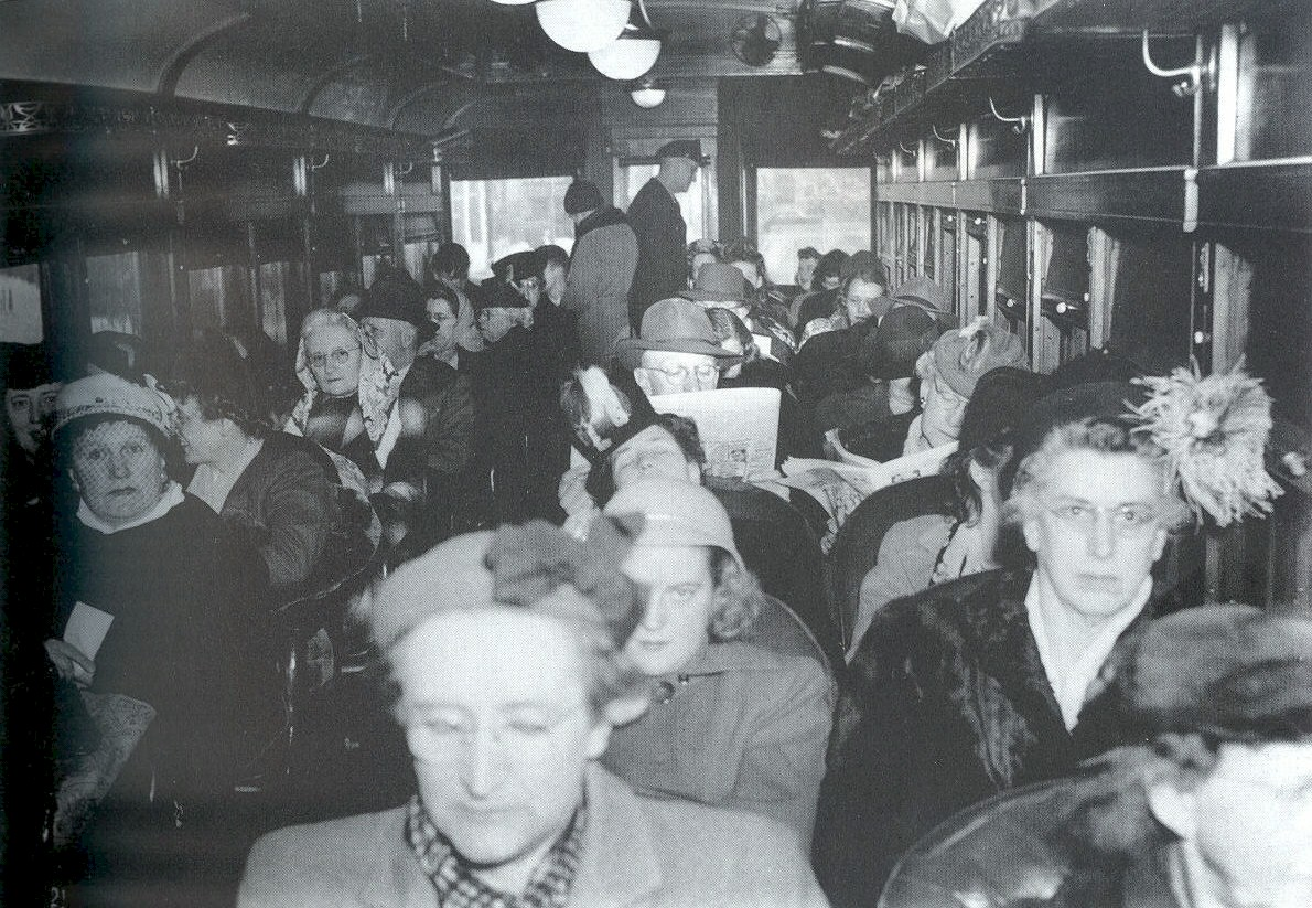 A large group of passengers inside the Interurban.