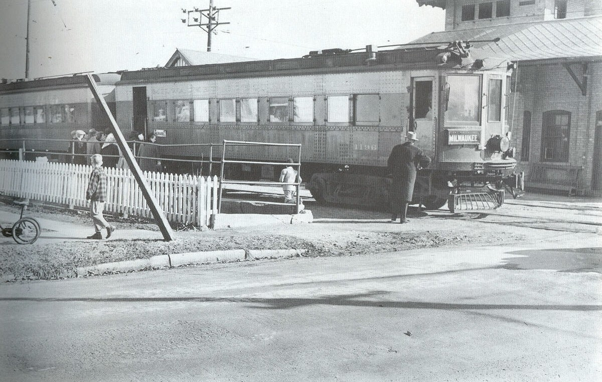 Interurban station with train parked.