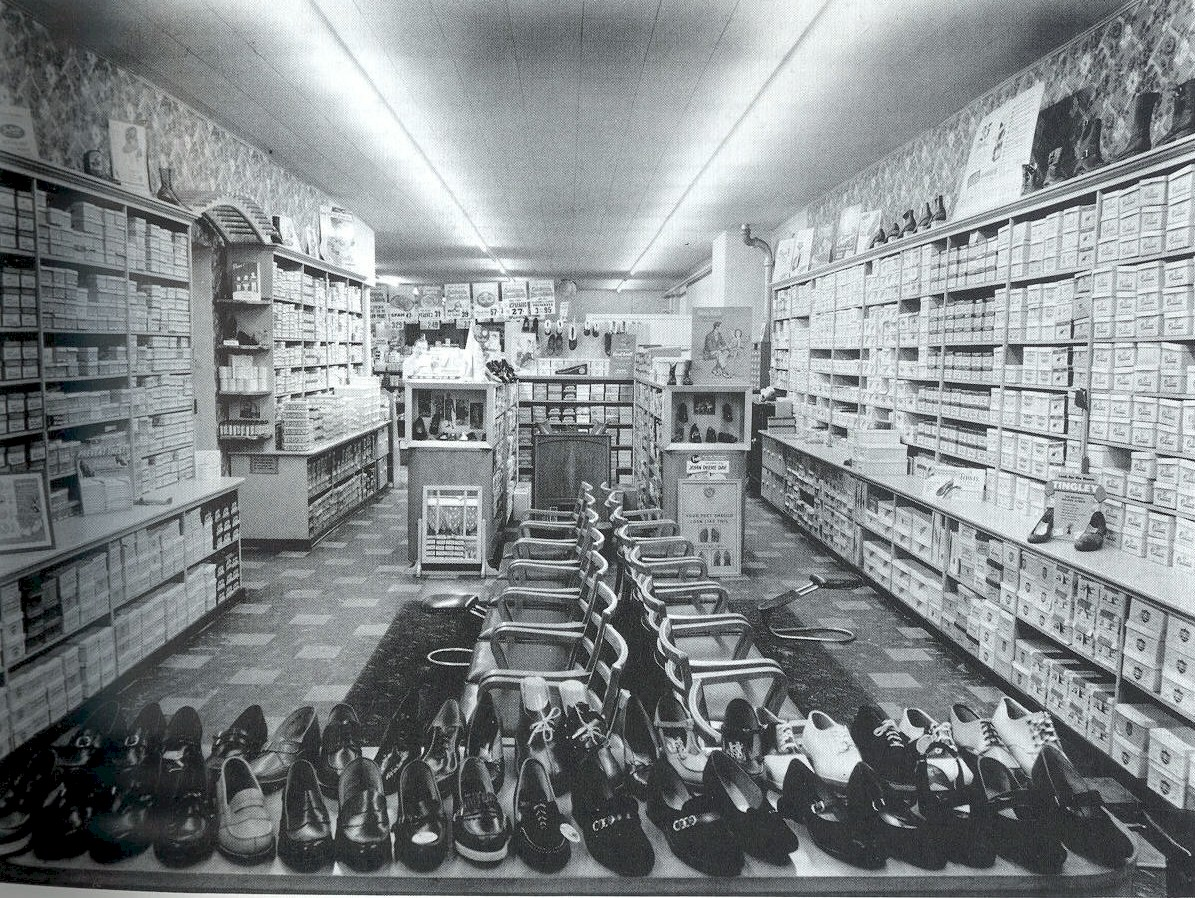 Rows of shoes and stacks of shoe boxes.