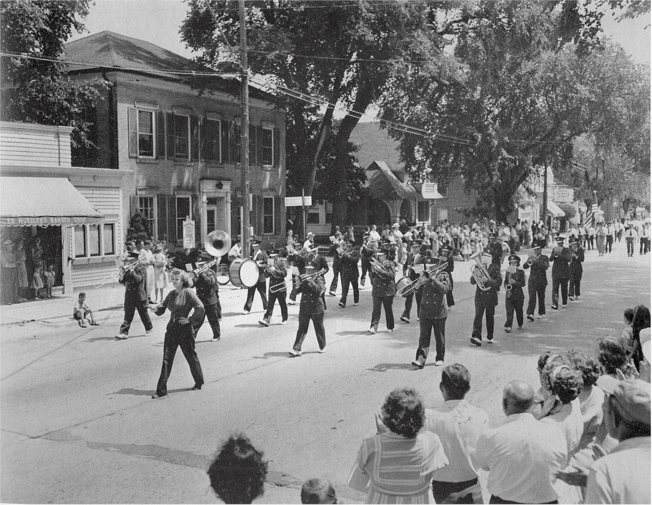 The Civic Band performing in uniforms during a parade.