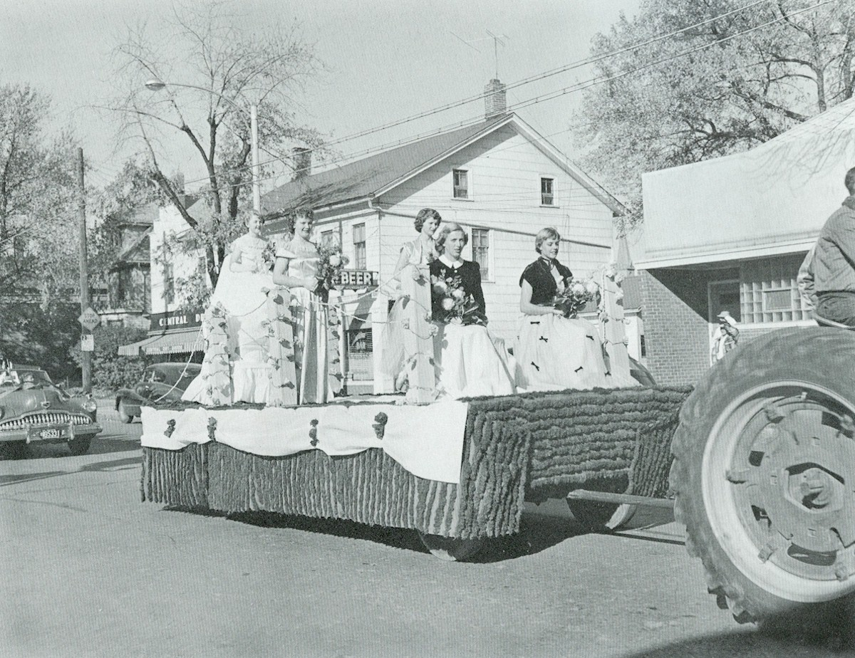 Ladies, including a queen of an event, riding on a float during the parade.