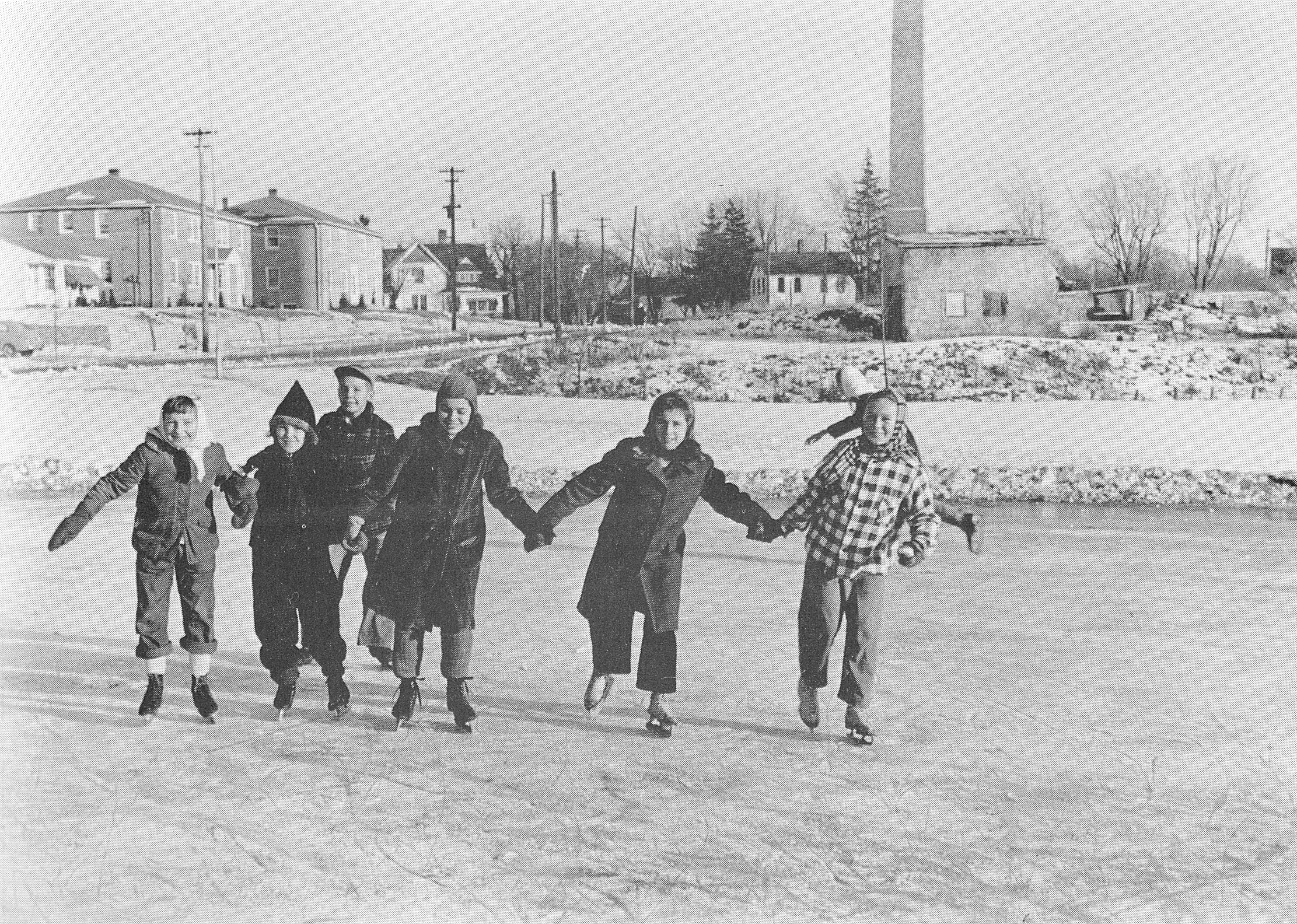 Group of children enjoying ice skating.