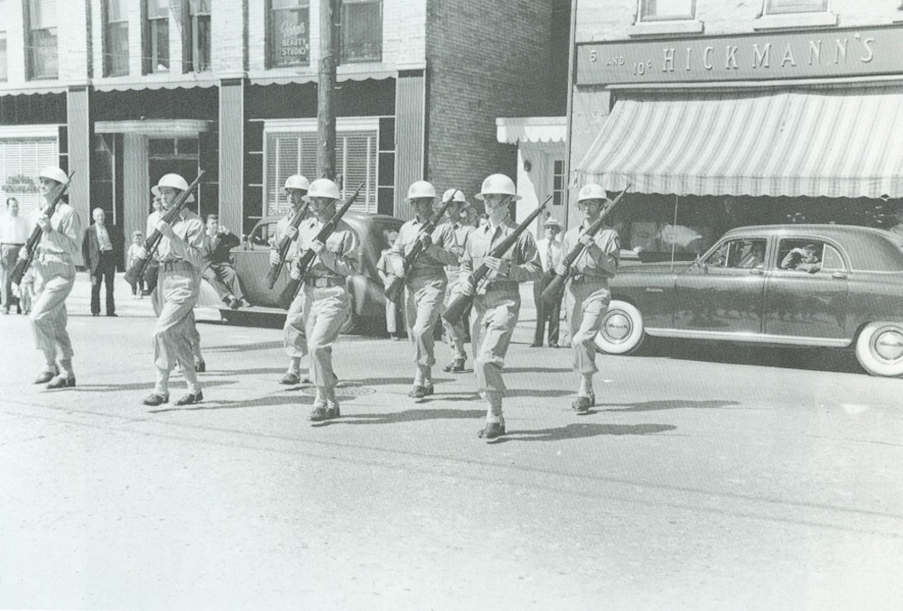 The VFW Drill Team performing in front of Hickman's.
