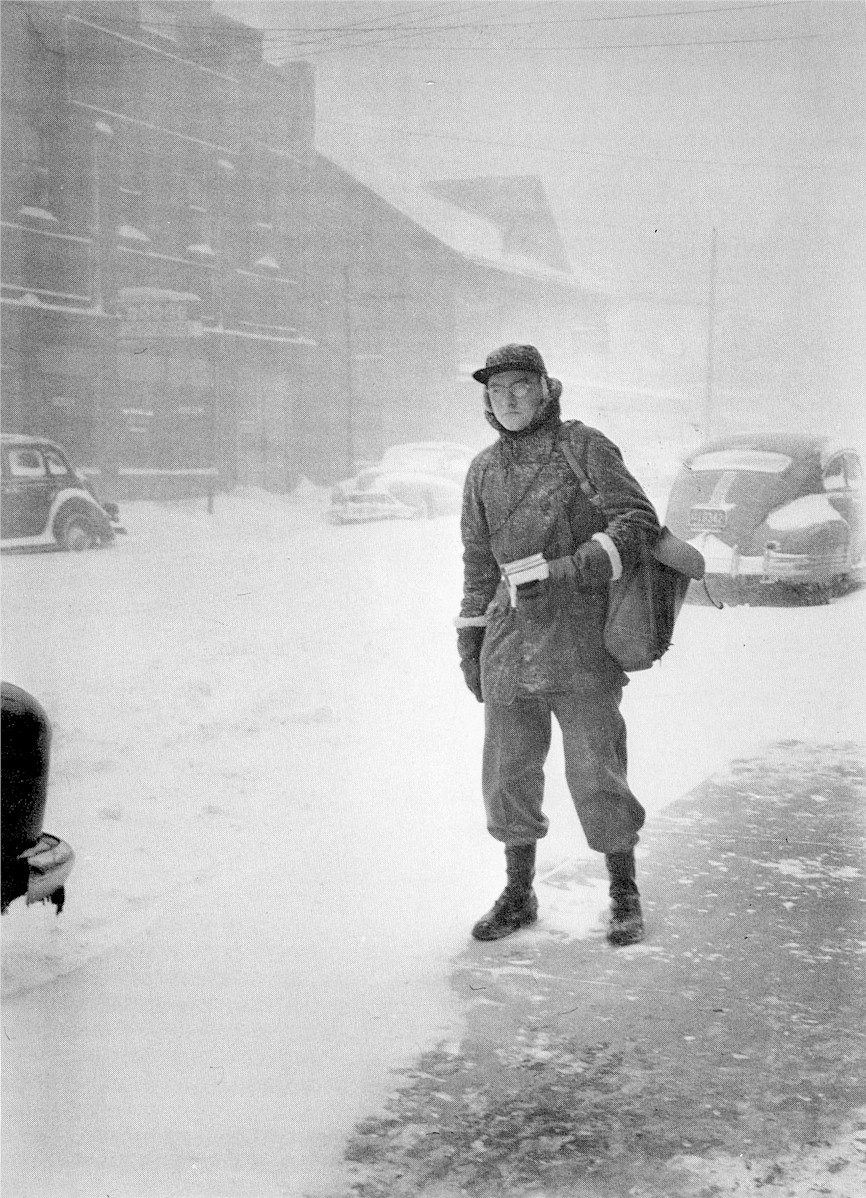 Postal worker working in the blizzard.