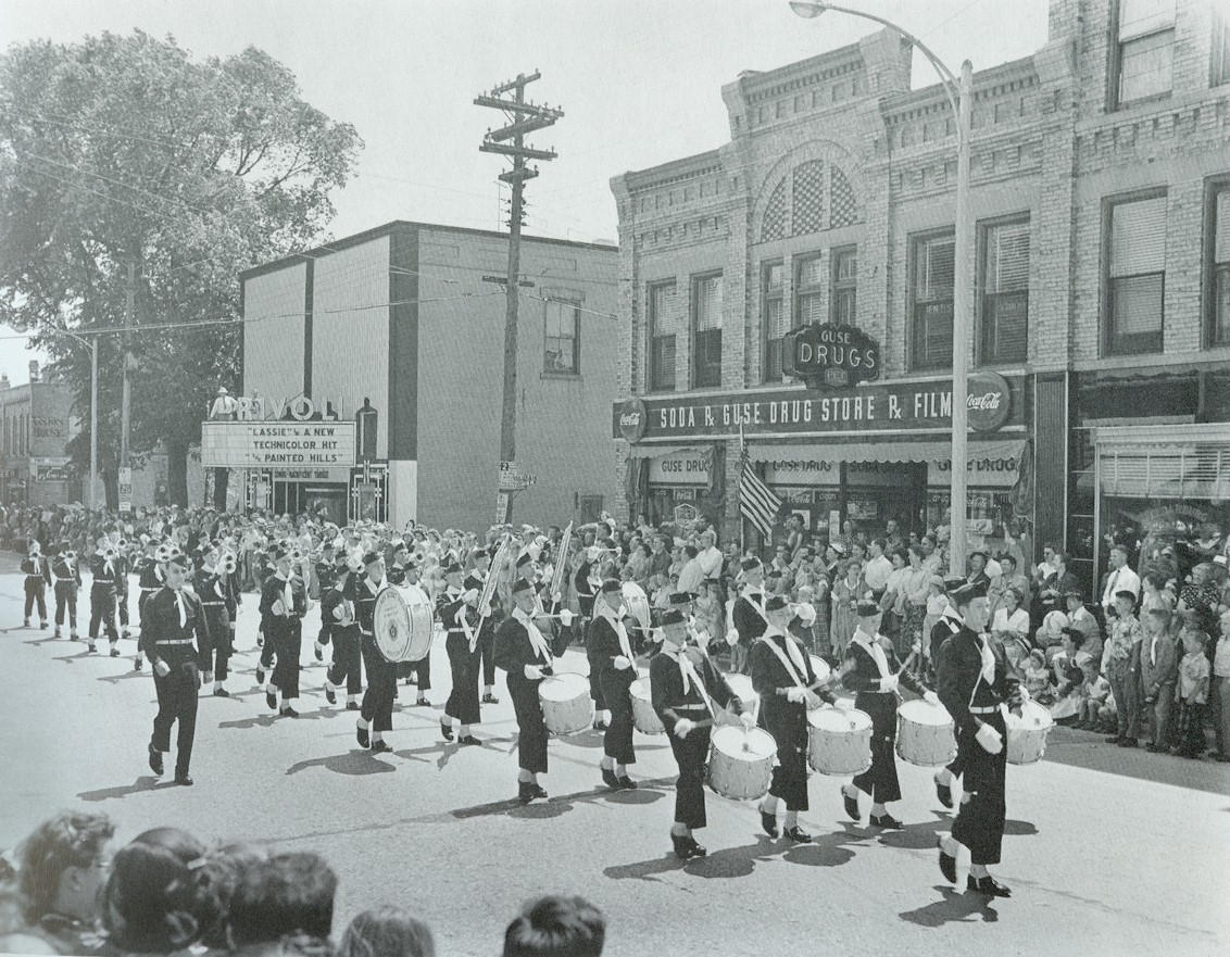 Band parading past the Washington House Inn and the Rivoli Theater.