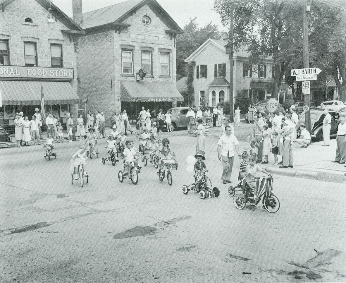 Children riding bikes and tricycles during the parade.