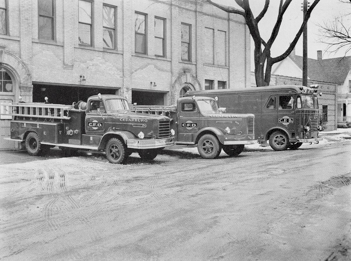 Fire Deparmtent's Station #2 with newer trucks parked in front.