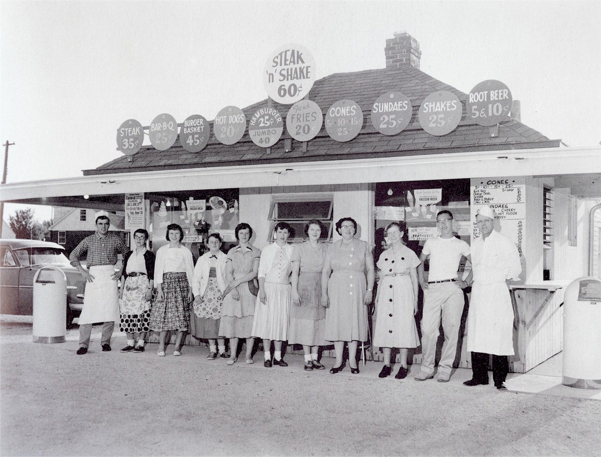 Uselding and his staff posing in front of the drive-in.
