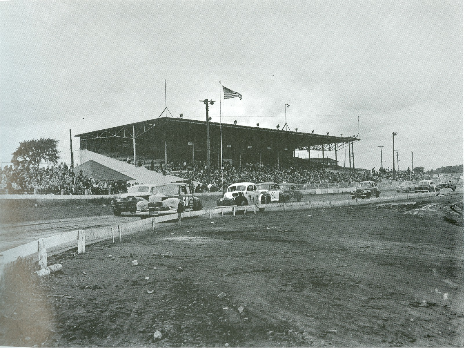 Stock car races on a track.