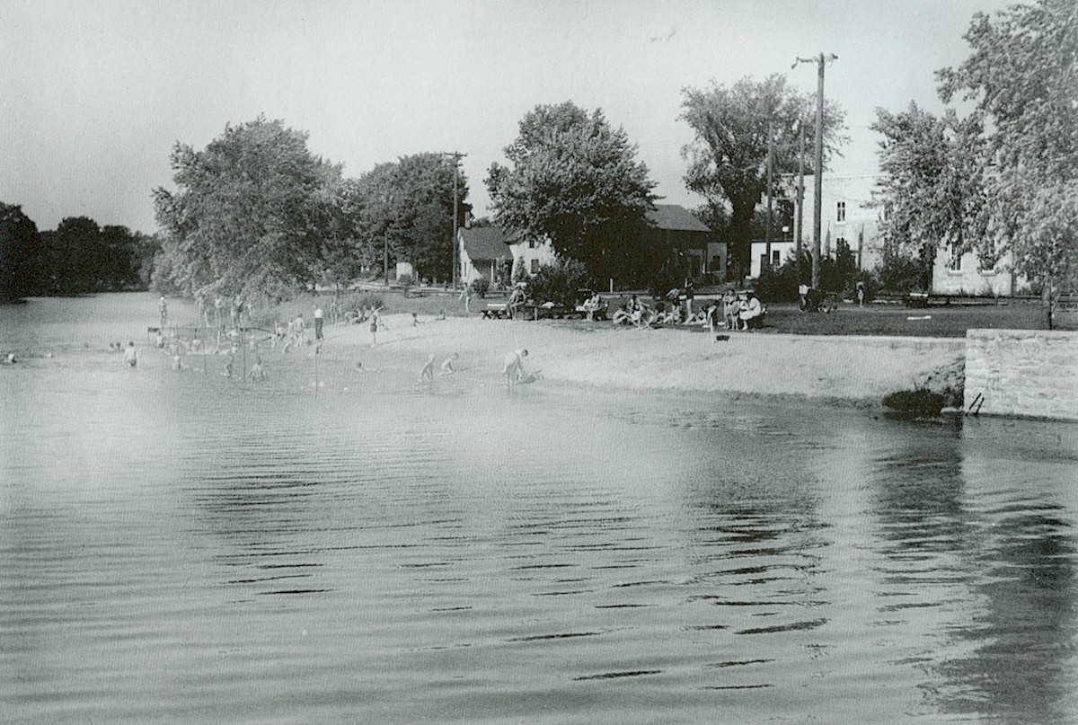 Group of people enjoying a swim in Cedar Creek.