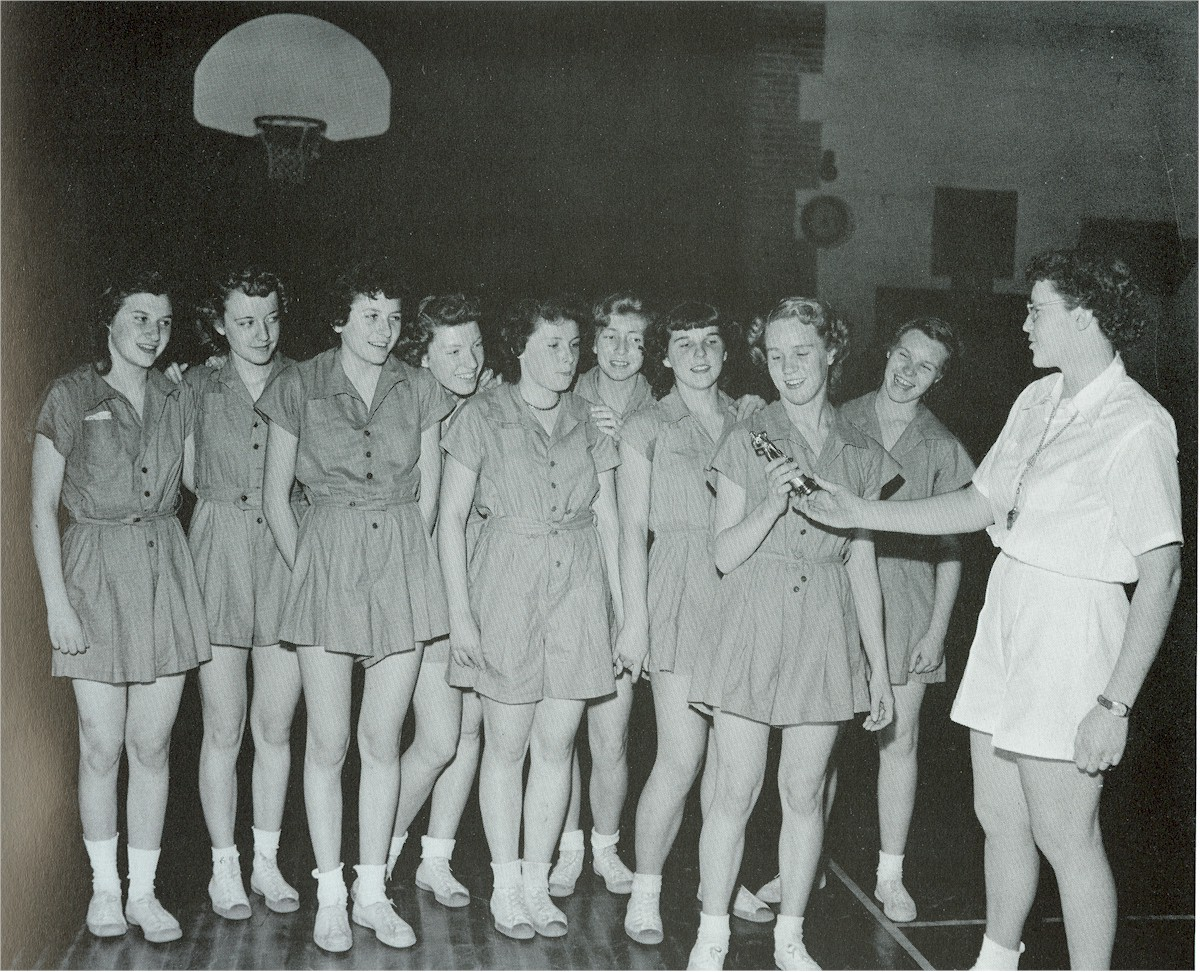 Girls basketball team receiving an award.