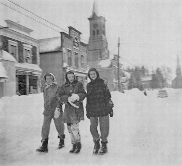 Three young ladies walking north on Washington Avenue in front of the Coffee Pot.
